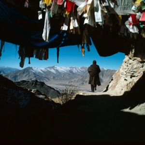 A pilgrim walks round Ganden monastery as a sign of devotion (Tibet)