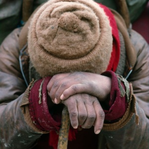 A porter worn out after a long walk on the Frozen River, Zanskar, Indian Himalayas