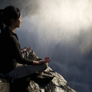 Varunee, a keen practicer of yoga and meditation, at the top of the Dettifoss falls in Iceland.