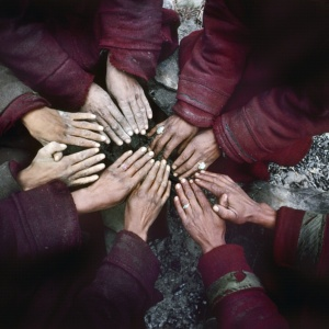 On the banks of the frozen river, village people from Zanskar warm their hands around the fire    (Indian Himalaya)